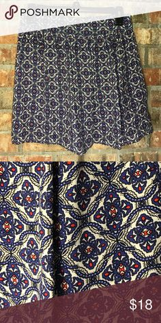 Blue/red/cream patterned skirt Blue/red/cream patterned skirt from Belk. Love the uniqueness of this pattern. The back section is elasticized. living doll Skirts
