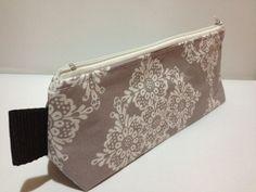 Triangle Zipper Pouch, Clutch, Purse, Pencil case - Linda Lace in Stone, Grey. €10.00, via Etsy.