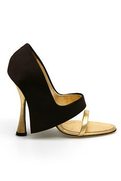 Manolo Blahnik! 2009 I think...I loved the design then and still love it now!! That's the secret of Manolo's.. They grow on you!! :)