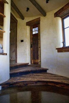 Straw bale building.- post & beam, straw bale with deliciously tinted handmade plaster walls.  Deep window ledges, built in shelves... Sigh.