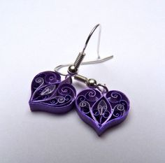 paper scrollwork earrings. No tutorial, just inspiration.