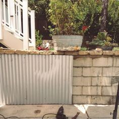 Genius Cover The Cinder Block Wall In Backyard With Corrugated Metal Via The Modern Design In 2020 Cinder Block Walls Concrete Block Walls Backyard