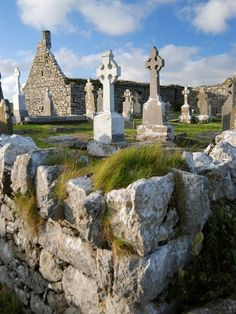 Celtic crosses mark graves outside a church in Doolin, a seaside town in County Clare