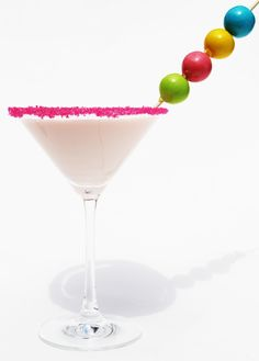 Bubble Gum Martini    1/4 cup whipping cream  1/4 cup milk  2 ounces Bubble Gum Vodka  Ice  Gumballs for garnish  Crystal sprinkles for garnish