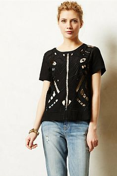 Embroidered Cutwork Blouse $158.00 She's wearing a skin-tone colored tank underneath.