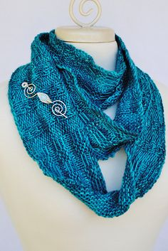 Ravelry: Lucaya Beach Knitting pattern for Cowl and Infinity scarf. Shown in Destination Yarns Souvenir colorways Bahamas and Shining Sea. Pattern used dk weight yarn. Worked in the round with slipped stitches this is a very quick knit.