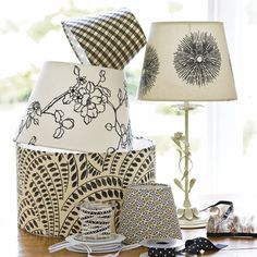 How to cover a lamp shade. I would have never thought of the way they created the pattern for the fabric.