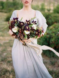 Eggplant-colored clematis bouquet