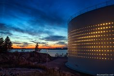 Helsinki: Silo 468, an old oil tank transformed into a piece of light art, located on the shore of Laajasalo district.