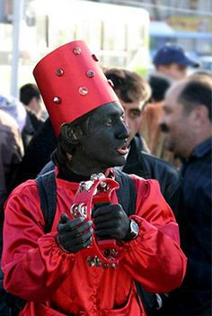 The traditional herald of the Nowruz season is a man called Hājī Firuz. He symbolizes the rebirth of the Sumerian god of sacrifice, Domuzi, who was killed at the end of each year and reborn at the beginning of the New Year.His face is painted black (black is an ancient Persian symbol of good luck) and wears a red costume. Then he sings and dances through the streets with tambourines and trumpets spreading good cheer and heralds the coming of the New Year.