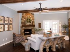Joanna warmed up the once bare living room with a natural stone fireplace, exposed beams and architectural accent pieces.