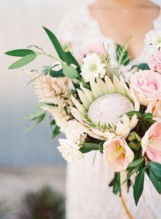Protea and rose wedding bouquet: Photography: Lauren Peele - http://www.laurenpeelephotography.com/