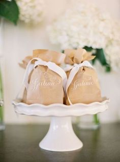 Brown paper bag and cream ribbon   Once Wed