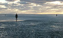 Another Place is a piece of modern sculpture by Antony Gormley.  Now permanently erected on Crosby Beach , England, the cast iron figures which face out to sea, spread over a 2 mile (3.2 km) stretch of the beach between Waterloo and Blundellsands. Each figure is 189 cm tall (nearly 6 feet 2½ inches) and weighs around 650 kg (over 1400 lb).  Well worth another visit.