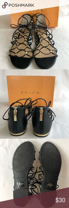 "NWB Unisa Gladiator Sandals Black w/ Gold Details The Unisa Kirana Sandals is embellished with gold rivets, lace ends and heel strip. It has laces that wraps around your ankle and tie. The heel  has a zipper detail.   Heel measures approximately 0.75 inches"" Material: Faux Leather Upper rubber sole Unisa Shoes Sandals"