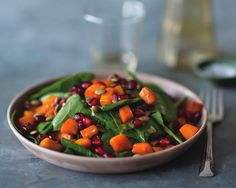 Perfect seasonal salad for the  holidays! Spinach Salad with Roasted Squash, Pumpkin Seeds, and Pomegranate by Ellie Krieger