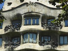 picture of gaudi's la pedrera, caption reads: Here is a closer look at the texture of Antoni Gaudi's La Pedrera. Here we can see the stone and iron work that forms the balconies.