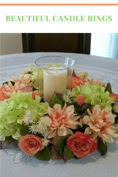 This spring candle centerpiece was made on a 12 inch grapevine base with light green hydrangeas, peach dahlias, peach roses, and an assortment of pretty greenery