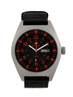 SA 8910 by Swiss Army. Masculine yet fashionable watch, stainless steel case and black canvas strap make this Analog watch look so fashionable, this masculine watch is water resistant, strap length 23 cm, diameter 4,5 cm.     http://www.zocko.com/z/JGrQo