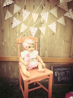 First Birthday Idea: Set up a simple photo booth to capture all the guests! #firstbirthday