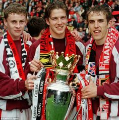 Ole Gunnar Solskjaer, David Beckham and Phil Neville pictured with the trophy