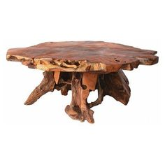 """Stump coffee table - I love how this skips """"rustic"""" and goes straight to """"fairytale"""""""