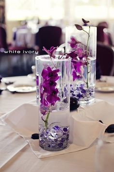 Purple orchid centerpieces with submersible LED lights.