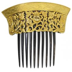 Art Nouveau haircomb made with Gold and tortoise shell and a citrine stone.