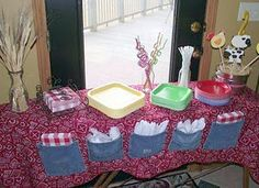 O.K. I am in LOOOOVE with this idea! Use denim pockets sewn onto a table cloth to hold utensils etc. at your party. This would also help to hold your tablecloth down at outside parties. I would go a step further and attach appliques or patches to match my theme.  Imagine a 4th of July party with fireworks and flags on the pockets. Yep and Bella can even help make these with a hot glue gun:)