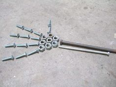 Google Image Result for http://www.instructables.com/image/FZ2YP9CPA8EP27TR5H/Find-some-scrap-nuts-and-bults.jpg