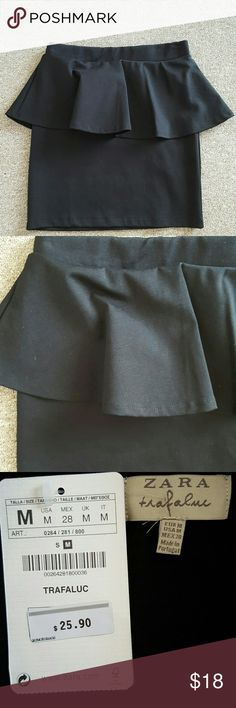 """Zara Trafaluc peplum skirt Never worn mini peplum skirt. Purchased maybe three or four years ago and unfortunately never saw the light of day. Give it a good home!  For reference, I bought this when I measured 26"""" in the waist and 34"""" in the hips. I'm 5'0"""" and this ends at about mid-thigh. Zara Skirts"""