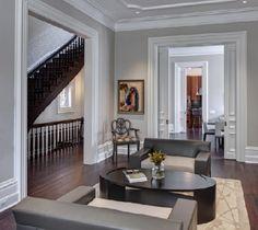 dark floors, tall baseboards, large crown moulding