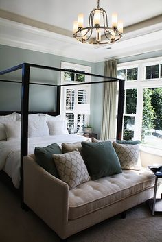 picture with bluer walls.  like the four poster and sofa for you (altho I think your sofa chaise would have to go in front of window) - and adding molding and lighting for character.