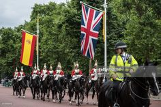 Members of the Household Cavalry, escorted by a mounted police officer, ride past Spanish and Union Flags that have been hung along The Mall ahead of the state visit by King Felipe and Queen Letizia of Spain, on July 11, 2017 in London, England. The visit was originally planned from 6th to 8th June but was postponed and will now take place on 12th to 14th July 2017.