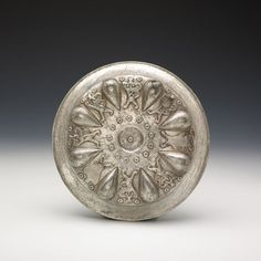 """Omphalos Bowl with Winged Lions Silver. Persian Empire. Achaemenid, 5th–4th century B.C. British Museum, London (135571). Photograph © The Trustees of the British Museum. All rights reserved. Part of an exhibition """"The Cyrus Cylinder and Ancient Persia: Charting a New Empire"""" June 20–August 4, 2013"""