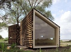Flake House by Olgga Architects, a 237 sq ft cabin in two pieces with the bathroom in a separate structure from the living/sleeping room