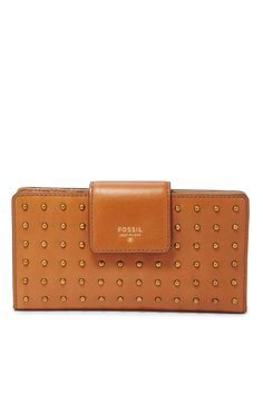 """Slimmed down (plus storage), this dotted clutch in soft pebbled camel leather carries it all without the bulk, letting you cache and carry up to 12 cards. Interior Details: 12 Credit Card Slots, 1 ID Window, 4 Slide Pockets Interior, exterior details: 1 Back Zipper Pocket Closure: Snap Silhouette:    Tab Clutch Measurements: 6.75""""L x 0.5""""W x 3.5""""H   Tab Clutch Camel by Fossil. Bags - Wallets & Wristlets Omaha, Nebraska"""