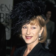 """Helen Mirren's Changing Looks - 1997 She wore a feathered hat she called """"my bird's nest"""" to pick up her Golden Globe for Losing Chase. Joan Rivers and others panned the look, causing Mirren to quip, """"I'm going to wear garbage bags from now on."""""""