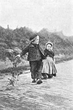 Dutch boy and girl in their woden shoes. 1906