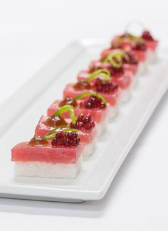 "Tuna sashimi on kaffir-lime-scented rice with hibiscus ""caviar,"" by BG Events and Catering in Boston. Photo: Gary Tardiff for BizBash"