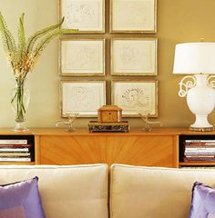 Stacking framed artwork in columns is an easy way to create visual interest to an otherwise blank wall - Traditional Home® / Photo: Colleen Duffley / Design: Jan Showers
