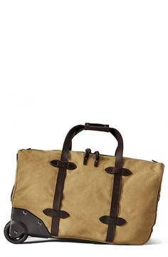4b9543bc0b Shop men s rolling duffel bag beige from Filson in our fashion directory.