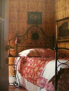 Bed with Iron Bedstead in the Corner of the Room ....