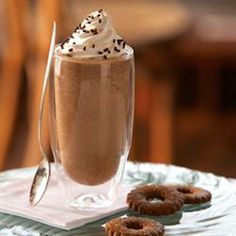 Folgers Frozen Mocha Coffee  1/4 cup strong brewed Folgers® French Roast Coffee   Or 1/4 cup strong brewed Folgers® Black Silk Coffee, chilled   1/4 cup Smucker's® Sundae Syrup™ Chocolate Flavored Syrup   1 tablespoon vanilla flavored syrup*   1/4 cup cold milk   1 1/2 cups ice cubes   Whipped cream   Chocolate decorator sprinkles, for garnish