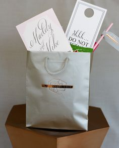 Welcome bags from Gracious Bridal were customized with the bride and groom's wedding logo. Snacks from local companies including Old Dutch Potato Chips, Salted Nut Rolls, Angie's Boomchickapop popcorn, and staples such as Advil, water, and mints filled them up.