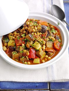 Moroccan veg and chickpea tagging - This recipe for Moroccan veg and chickpea tagine is vegan, low-fat and really easy to make. This makes enough for four, but the leftovers freeze well.