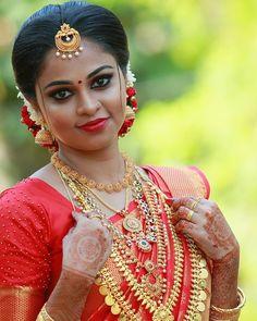Image may contain: 1 person, closeup Bridal Hairstyle Indian Wedding, Indian Wedding Bride, Bridal Hairdo, Desi Bride, Indian Bridal Hairstyles, Indian Bridal Fashion, South Indian Bride, Wedding Gold, Kerala Bride