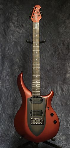 For sale is a brand new Sterling By MusicMan John Petrucci Majesty electric guitar, with the Iced Crimson matte finish.   Based on the Ernie Ball MusicMan John Petrucci Signature Series Majesty model,  this guitar  features a set mahogany neck with rosewood fretboard, a basswood body, and 12dB...