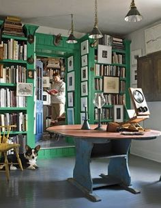 The whimsical and artistic library of Anne Gridley and Gary Graves, which has been painted in Benjamin Moore's Prairie Green. Located in the countryside, this is one of my all-time favourite libraries. So courageous, and yet so inviting.