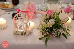 pink summer wedding table decoration - centerpiece, roses and peonies, together with a lovely candle birdcage
